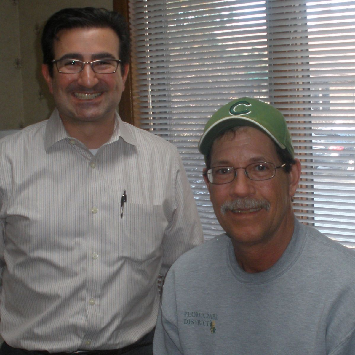 dr. sumer and patient smiling