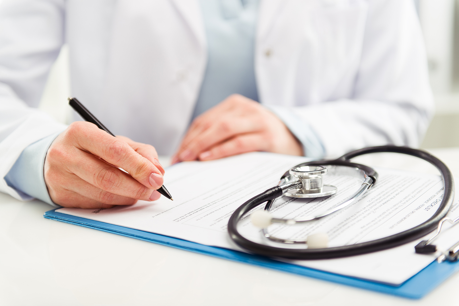 medical professional filling out patient form