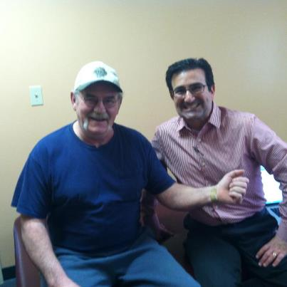 dr. sumer and a wrist injection patient smiling